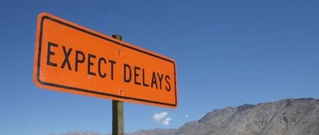 expect delays roadsign