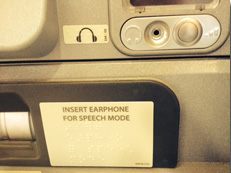 ATM headphone jack and sign